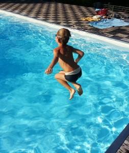 child-jumping-pool